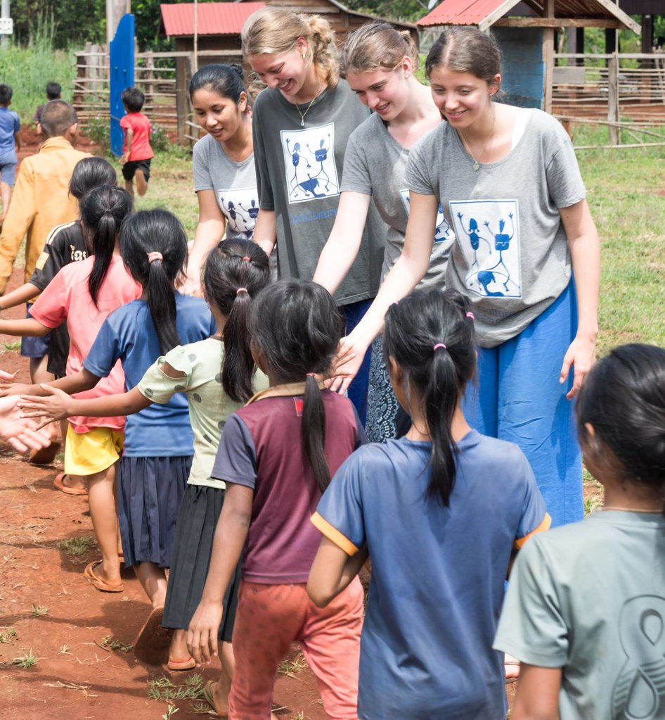 Students high five in Cambodia.
