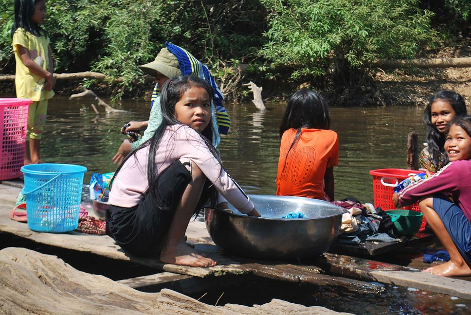 A girl in Cambodia doing household chores